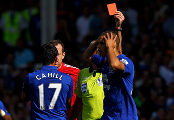 LIVERPOOL, ENGLAND - OCTOBER 01:  Jack Rodwell of Everton is shown a red card by Referee Martin Atkinson following a challenge on Luis Suarez of Liverpool during the Barclays Premier League match between Everton and Liverpool at Goodison Park on October 1