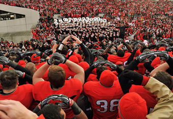 COLUMBUS, OH - NOVEMBER 27:  The Ohio State Buckeyes sing the school alma mater with the marching band after they defeated the Michigan Wolverines 37-7 at Ohio Stadium on November 27, 2010 in Columbus, Ohio.  (Photo by Jamie Sabau/Getty Images)
