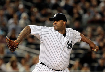 NEW YORK, NY - SEPTEMBER 30:  CC Sabathia #52 of the New York Yankees pitches against the Detroit Tigers during Game One of the American League Division Series at Yankee Stadium on September 30, 2011 in the Bronx borough of New York City.  (Photo by Chris