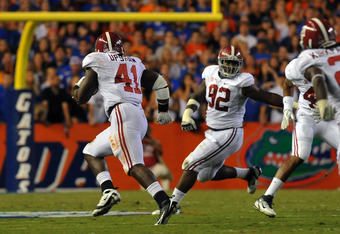 GAINESVILLE, FL -  OCTOBER 1:  Linebacker Courtney Upshaw #41 of the Alabama Crimson Tide intercepts a pass and runs for a touchdown against the Florida Gators October 1, 2011 at Ben Hill Griffin Stadium in Gainesville, Florida.  (Photo by Al Messerschmid