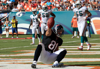 MIAMI GARDENS, FL - SEPTEMBER 18:  Houston Texans tight end Owen Daniels #81 reacts to a touchdown during a game against the Miami Dolphins  at Sun Life Stadium on September 18, 2011 in Miami Gardens, Florida.  (Photo by Sam Greenwood/Getty Images)