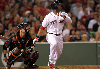 BOSTON, MA - SEPTEMBER 21:  Carl Crawford #13 of the Boston Red Sox knocks in two runs in the 4th against the Baltimore Orioles  at Fenway Park September 21, 2011 in Boston, Massachusetts. (Photo by Jim Rogash/Getty Images)