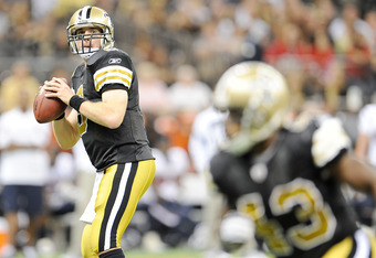 NEW ORLEANS, LA - SEPTEMBER 25:  Drew Brees #9 of the New Orleans Saints drops back to pass during a game being held at the Louisiana Superdome on September 25, 2011 in New Orleans, Louisiana.  The Saints deated the Texans 40-33.  (Photo by Stacy Revere/G