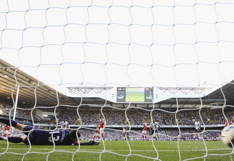 LONDON, ENGLAND - OCTOBER 02:  Kyle Walker of Tottenham Hotspur scores his side's second goal past Wojciech Szczesny of Arsenal during the Barclays Premier League match between Tottenham Hotspur and Arsenal at White Hart Lane on October 2, 2011 in London,