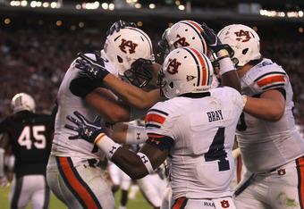 Auburn offense celebrates go ahead touchdown