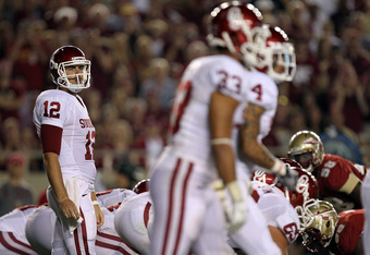 TALLAHASSEE, FL - SEPTEMBER 17:  Landry Jones #12 of the Oklahoma Sooners at Doak Campbell Stadium on September 17, 2011 in Tallahassee, Florida.  (Photo by Ronald Martinez/Getty Images)
