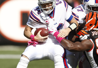 CINCINNATI, OH - OCTOBER 2:   Ryan Fitzpatrick #14 of the Buffalo Bills is sacked by Michael Johnson #93 of the Cincinnati Bengals during  their game on October 2, 2011 at Paul Brown Stadium in Cincinnati, Ohio.  The Bengals defeated the Bills 23-20.  (Ph