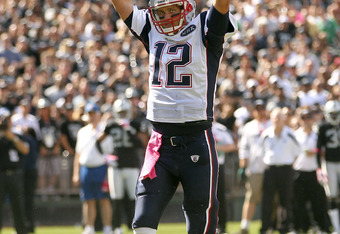 OAKLAND, CA - OCTOBER 02:  Tom Brady #12 of the New England Patriots celebrates after the Patriots scored a touchdown against the Oakland Raiders at O.co Coliseum on October 2, 2011 in Oakland, California.  (Photo by Ezra Shaw/Getty Images)