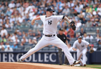 NEW YORK, NY - SEPTEMBER 25:  A.J. Burnett #34 of the New York Yankees pitches against the Boston Red Sox on September 25, 2011 at Yankee Stadium in the Bronx borough of New York City.  (Photo by Nick Laham/Getty Images)