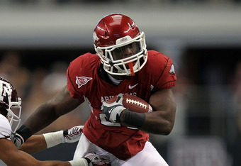 ARLINGTON, TX - OCTOBER 01:  Ronnie Wingo Jr. #20 of the Arkansas Razorbacks runs against Trent Hunter #1 of the Texas A&M Aggies at Cowboys Stadium on October 1, 2011 in Arlington, Texas.  (Photo by Ronald Martinez/Getty Images)