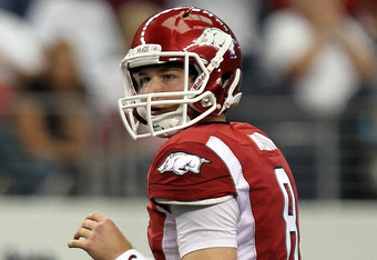 ARLINGTON, TX - OCTOBER 01:  Quarterback Tyler Wilson #8 of the Arkansas Razorbacks throws against the Texas A&M Aggies at Cowboys Stadium on October 1, 2011 in Arlington, Texas.  (Photo by Ronald Martinez/Getty Images)