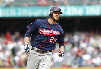 CLEVELAND, OH - SEPTEMBER 25: Rene Tosoni #23 of the Minnesota Twins rounds the bases after hitting a home run during the tenth inning in their game against the Cleveland Indians on September 25, 2011 at Progressive Field in Cleveland, Ohio. The Twins def