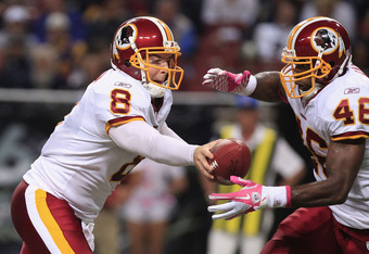 ST. LOUIS, MO - OCTOBER 2:  Rex Grossman #8 makes the handoff to Ryan Torain #46 of the Washington Redskins October 2, 2011 at the Edward Jones Dome in St. Louis, Missouri. The Redskins defeated the Rams 17-10. (Photo by Whitney Curtis/Getty Images)