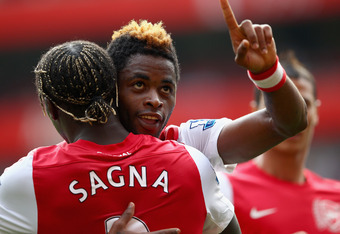 LONDON, ENGLAND - SEPTEMBER 24:  Alex Song of Arsenal celebrates his goal with team mate Bacary Sagna during the Barclays Premier League match between Arsenal and Bolton Wanderers at Emirates Stadium on September 24, 2011 in London, England.  (Photo by Cl