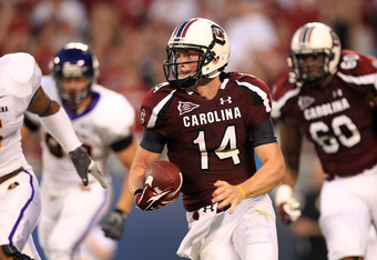 CHARLOTTE, NC - SEPTEMBER 03:  Connor Shaw #14 of the South Carolina Gamecocks watches on against the East Carolina Pirates during their game at Bank of America Stadium on September 3, 2011 in Charlotte, North Carolina.  (Photo by Streeter Lecka/Getty Ima