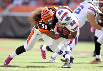CINCINNATI, OH - OCTOBER 02:  Fred Jackson #22 of the Buffalo Bills is tackled by Rey Maualuga #58 of the Cincinnati Bengals during the game at Paul Brown Stadium on October 2, 2011 in Cincinnati, Ohio.  (Photo by Andy Lyons/Getty Images)