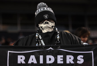 DENVER, CO - SEPTEMBER 12:  A fan of the Oakland Raiders supports his team against the Denver Broncos at Sports Authority Field at Mile High on September 12, 2011 in Denver, Colorado.  (Photo by Doug Pensinger/Getty Images)