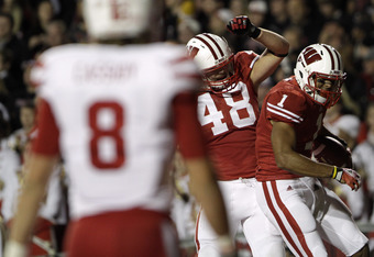 MADISON, WI - OCTOBER 1: Nick Toon #1 of the Wisconsin Badgers celebrates scoring a touchdown on the Nebraska Cornhuskers with teammate Jacob Pedersen #48 October 1, 2011 at Camp Randall stadium in Madison, Wisconsin.  (Photo by John Gress/Getty Images)