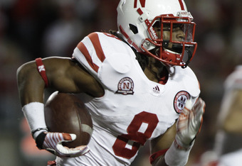 MADISON, WI - OCTOBER 01: Ameer Abdullah #8 of the Nebraska Cornhuskers takes on the Wisconsin Badgers  October 1, 2011 at Camp Randall stadium in Madison, Wisconsin. Wisconsin won the game 48-17.  (Photo by John Gress/Getty Images)