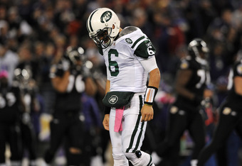 BALTIMORE, MD - OCTOBER 2: Quarterback Mark Sanchez #6 of the New York Jets walks to the sideline after being sacked by nose tackle Haloti Ngata #92 of the Baltimore Ravens (not pictured) and fumbling, which led to a Baltimore Ravens touchdown, in the sec