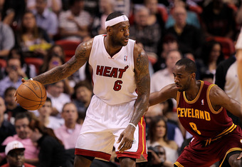 MIAMI, FL - JANUARY 31: LeBron James #6 of the Miami Heat posts up Christian Eyenga #8 of the Cleveland Cavaliers during a game at American Airlines Arena on January 31, 2011 in Miami, Florida. NOTE TO USER: User expressly acknowledges and agrees that, by