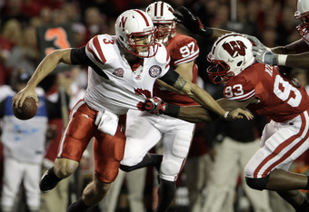 MADISON, WI - OCTOBER 1: Louis Nzegwu #93 of the Wisconsin Badgers pressures Taylor Martinez #3 of the Nebraska Cornhuskers October 1, 2011 at Camp Randall Stadium in Madison, Wisconsin.  (Photo by John Gress/Getty Images)