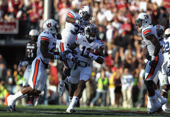 COLUMBIA, SC - OCTOBER 01:  Demetruce McNeal #12 of the Auburn Tigers celebrates with Jermaine Whitehead #32 of the Auburn Tigers after an interception during their game against the South Carolina Gamecocks at Williams-Brice Stadium on October 1, 2011 in
