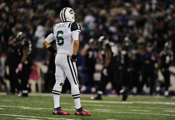 BALTIMORE, MD - OCTOBER 2: Quarterback Mark Sanchez #6 of the New York Jets reacts after throwing an interception in the third quarter that led to a touchdown against the Baltimore Ravens at M&T Bank Stadium on October 2, 2011 in Baltimore, Maryland. Balt