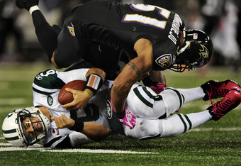 BALTIMORE, MD - OCTOBER 2: Quarterback Mark Sanchez #6 of the New York Jets is hit by linebacker Brendon Ayanbadejo #51 of the Baltimore Ravens during the second quarter at M&T Bank Stadium on October 2, 2011 in Baltimore, Maryland. (Photo by Patrick Smit