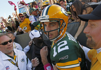 GREEN BAY, WI - OCTOBER 2: Aaron Rodgers #12 of the Green Bay Packers exits the stands after scoring a touchdown against the Denver Broncos at Lambeau Field on October 2, 2011 in Green Bay, Wisconsin.  (Photo by Matt Ludtke /Getty Images)