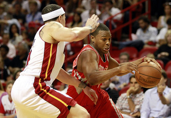 MIAMI, FL - MARCH 27:  Guard Mike Bibby #0 of the Miami Heat defends against gurad Kyle Lowry #7 of the Houston Rockets  at American Airlines Arena on March 27, 2011 in Miami, Florida. NOTE TO USER: User expressly acknowledges and agrees that, by download