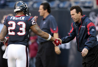 HOUSTON, TX - JANUARY 02:  Head coach Gary Kubiak of the Houston Texans greets running back Arian Foster #23 before playing the Jacksonville Jaguars at Reliant Stadium on January 2, 2011 in Houston, Texas.  (Photo by Bob Levey/Getty Images)