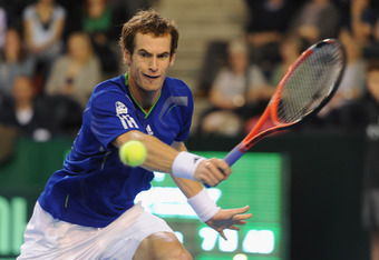 GLASGOW, SCOTLAND - SEPTEMBER 18:  Andy Murray of Great Britain in action against Gyorgy Balazs of Hungary during day three of the Davis Cup tie between Great Britain and Hungary at the Braehead Arena on September 18, 2011 in Glasgow, Scotland.  (Photo by