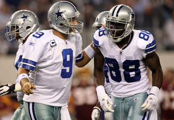 ARLINGTON, TX - SEPTEMBER 26:  Tony Romo #9 talks with  Dez Bryant #88 of the Dallas Cowboys during play against the Washington Redskins at Cowboys Stadium on September 26, 2011 in Arlington, Texas.  (Photo by Ronald Martinez/Getty Images)