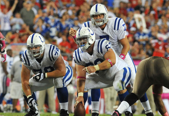 TAMPA, FL - OCTOBER 3:  Quarterback Curtis Painter #7 of  the Indianapolis Colts sets for a play behind center Jeff Saturday #63  against the Tampa Bay Buccaneers October 3, 2011 at Raymond James Stadium in Tampa, Florida. (Photo by Al Messerschmidt/Getty
