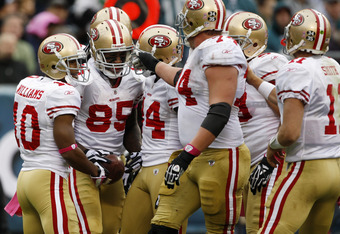 PHILADELPHIA, PA - OCTOBER 02: Tight end Vernon Davis #85 of the San Francisco 49ers is congratulated by teammates wide receiver Kyle Williams #10, wide receiver Josh Morgan #84, offensive tackle Joe Staley #74, guard Jonathan Goodwin #59 and quarterback