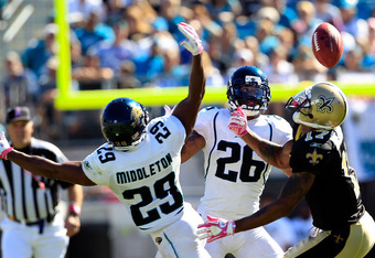 JACKSONVILLE, FL - OCTOBER 02:   Dawan Landry #26 of the Jacksonville Jaguars and William Middleton #29 attempt to make an interception against  Robert Meachem #17 of the New Orleans Saints during a game at EverBank Field on October 2, 2011 in Jacksonvill