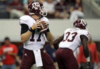 ARLINGTON, TX - OCTOBER 01:  Quarterback Ryan Tannehill #17 of the Texas A&M Aggies throws against the Arkansas Razorbacks at Cowboys Stadium on October 1, 2011 in Arlington, Texas.  (Photo by Ronald Martinez/Getty Images)
