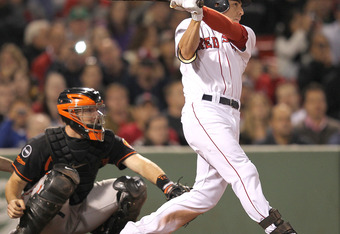 BOSTON, MA - SEPTEMBER 19:  Jacoby Ellsbury #2 of the Boston Red Sox connects, sending the ball to deep right,  for an inside the park home against the Baltimore Orioles defends in the seventh inning during the second game of a doubleheader at Fenway Park