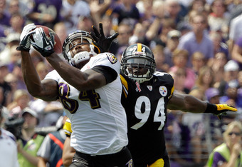 BALTIMORE, MD - SEPTEMBER 11:  Ed Dickson #84 of the Baltimore Ravens catches a pass in front of  Lawrence Timmons #94 of the Pittsburgh Steelers  during the season opener at M&T Bank Stadium on September 11, 2011 in Baltimore, Maryland. The play was call