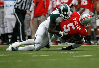 COLUMBUS, OH - OCTOBER 1:  Braxton Miller #5 of the Ohio State Buckeyes is sacked by Chris Norman #10 of the Michigan State Spartans during the second half on October 1, 2011 at Ohio Stadium in Columbus, Ohio. Michigan State defeated Ohio State 10-7. (Pho