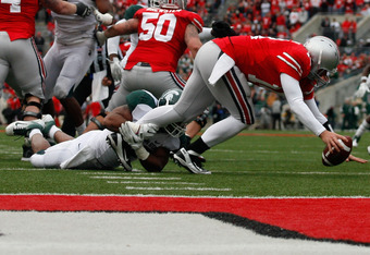 COLUMBUS, OH - OCTOBER 1:  Denicos Allen #28 of the Michigan State Spartans sacks Joe Bauserman #14 of the Ohio State Buckeyes during the second half on October 1, 2011 at Ohio Stadium in Columbus, Ohio. Michigan State defeated Ohio State 10-7. (Photo by