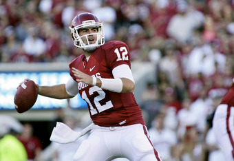 NORMAN, OK - OCTOBER 1:  Quarterback Landry Jones #12 of the Oklahoma Sooners looks to throw in the first half against the Ball State Cardinals on October 1, 2011 at Gaylord Family-Oklahoma Memorial Stadium in Norman, Oklahoma.  Oklahoma defeated Ball Sta