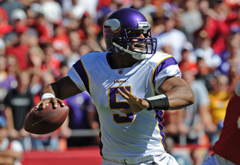 KANSAS CITY, MO - OCTOBER 02:  Quarterback Donovan McNabb #5 of the Minnesota Vikings drops back to pass against the Kansas City Chiefs during the first quarter on October 2, 2011 at Arrowhead Stadium in Kansas City, Missouri.  (Photo by Peter Aiken/Getty