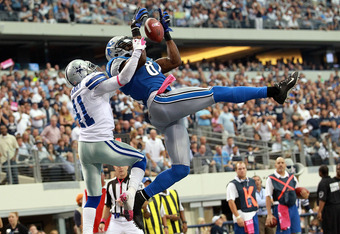 ARLINGTON, TX - OCTOBER 02:  Calvin Johnson #81 of the Detroit Lions makes a touchdown pass reception for the win over Terence Newman #41 of the Dallas Cowboys at Cowboys Stadium on October 2, 2011 in Arlington, Texas. The Lions defeated the Cowboys 34-30