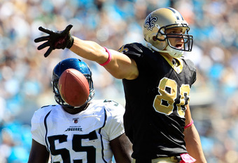JACKSONVILLE, FL - OCTOBER 02:   Jimmy Graham #80 of the New Orleans Saints celebrates a reception against  Clint Session #55 of the Jacksonville Jaguars during a game at EverBank Field on October 2, 2011 in Jacksonville, Florida.  (Photo by Sam Greenwood