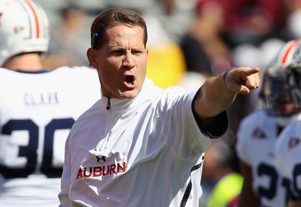 COLUMBIA, SC - OCTOBER 01:  Head coach Gene Chizik of the Auburn Tigers yells to his team before their game against the South Carolina Gamecocks at Williams-Brice Stadium on October 1, 2011 in Columbia, South Carolina.  (Photo by Streeter Lecka/Getty Imag