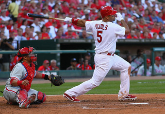 ST. LOUIS, MO - OCTOBER 4: Albert Pujols #5 of the St. Louis Cardinals hits his second double of the game against the Philadelphia Phillies during game three of the National League Division Series at Busch Stadium on October 4, 2011 in St. Louis, Missouri