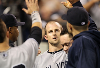 DETROIT, MI - OCTOBER 04:  Brett Gardner #11 of the New York Yankees celebrates in the dugout after scoring on a double by Curtis Granderson #14 in the fifth inning of Game Four of the American League Division Series at Comerica Park on October 4, 2011 in