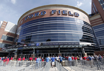 DETROIT, MI - SEPTEMBER 18:  Football fans go through security checks before entering Ford Field prior to the start of the game between the Kansas City Chiefs and the Detroit Lions on September 18, 2011 in Detroit, Michigan.  (Photo by Leon Halip/Getty Im